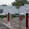 """PARAMUS, NEW JERSEY - AUGUST 6, 2016: Tesla Service Center Supercharger with """"Tesla Electric Vehicle Parking"""" sign."""