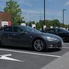 NEWARK, DELAWARE - JULY 20, 2016: Two Tesla vehicles supercharging at Delaware Welcome Center Supercharger.
