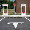 "NEWARK, DELAWARE - JULY 20, 2016: Tesla Supercharger, with Tesla logo on parking lot and ""Tesla Vehicle Charging Only"" Sign"