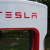 """EAST BRUNSWICK, NEW JERSEY - JULY 20, 2016: Tesla Supercharger close up with """"No Parking Electric Vehicle Charging Only"""" sign at"""