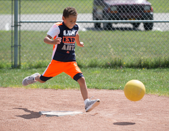 JOED VIERA/STAFF PHOTOGRAPHER-Lockport, NY- Trey Patterson, 6, winds up for a kick during a YWCA Niagara Frontier Summer Day Camp kickball game.