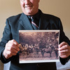 JOED VIERA/STAFF PHOTOGRAPHER-Wilson, NY-David Ross, of Hamilton and Clark Funeral Parlor holds up an old photograph at the Parlor.