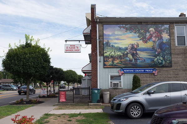 JOED VIERA/STAFF PHOTOGRAPHER-Newfane, NY- The Newfane Country Proud Mural hangs on the side of Bob Eadie's Barber Shop.