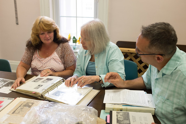 JOED VIERA/STAFF PHOTOGRAPHER-Lockport, NY-Chairperson Wendy Andrews, Marty Whitehead and Pastor David McBeath look over old photographs of First Baptist's time gone by.