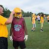 JOED VIERA/STAFF PHOTOGRAPHER-Lockport, NY-Head Coach Matt Vermette fastens Keyun Hamilton,17, helmet during Lockport High School's first football practice of the season.