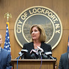 JOED VIERA/STAFF PHOTOGRAPHER-Lockport, NY- Lockport City Police Detective Lt. Todd Chenez and City Attorney John Ottaviano sand by as Lockport Mayor Anne McCaffrey answers questions asked at a press conference held at City Hall.