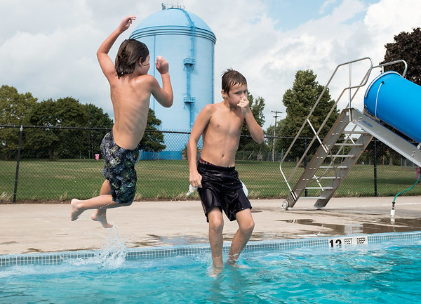 JOED VIERA/STAFF PHOTOGRAPHER-Lockport, NY-  Benjamin Fifield 12 and Alex White 11 jump into the Lockport Community Pool.