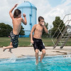 JOED VIERA/STAFF PHOTOGRAPHER-Lockport, NY-  Benjamin Fifield 12 and Alex White 11 jump into the Lockport Community Pool.