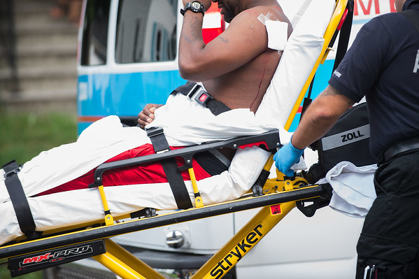 JOED VIERA/STAFF PHOTOGRAPHER-Lockport, NY- A stab victim is carted away by EMTs on Pine Street.