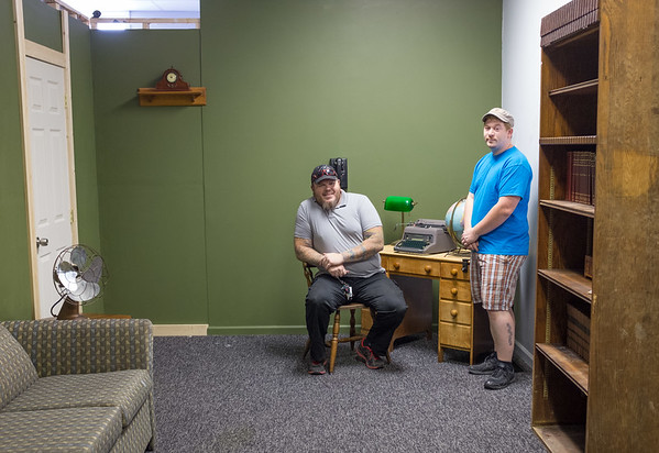 JOED VIERA/STAFF PHOTOGRAPHER-Lockport, NY- Into the Enigma: A Medina Escape Room Experience owners Mike LaBose and Tim Elliott sit in their escape room.