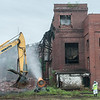 140423 JOED VIERA/STAFF PHOTOGRAPHER-Lockport, NY- EPA Crews tear down the  building on Wednesday July 23rd.