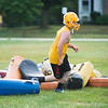JOED VIERA/STAFF PHOTOGRAPHER-Lockport, NY-A player throws pads into a pile before Lockport High School's first football practice of the season.