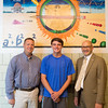 JOED VIERA/STAFF PHOTOGRAPHER-Lockport, NY- New York State Trig-Star coordinator Brian Skalman, PLS, Antonio Faraci, 17 and Lockport High School Principal Frank Novalli.