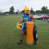JOED VIERA/STAFF PHOTOGRAPHER-Lockport, NY- A player carries pads to Lockport High School's first football practice of the season.