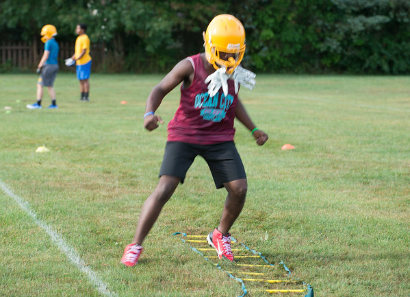 JOED VIERA/STAFF PHOTOGRAPHER-Lockport, NY-Keyun Hamilton,17, drills during Lockport High School's first football practice of the season.