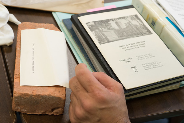 JOED VIERA/STAFF PHOTOGRAPHER-Lockport, NY-Pastor David McBeath looks at a brick from the 1867 Church.