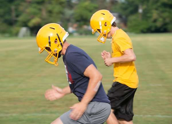 JOED VIERA/STAFF PHOTOGRAPHER-Lockport, NY- Players do drills during Lockport High School's first football practice of the season.