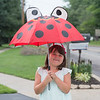JOED VIERA/STAFF PHOTOGRAPHER-Lockport, NY-Samantha Henley, 6, holds up her umbrella anticipating rain while walking with her grandmother on High Street.