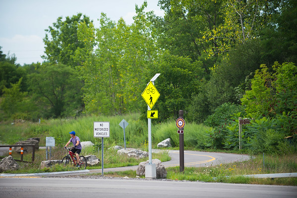 JOED VIERA/STAFF PHOTOGRAPHER-Lockport, NY- Paul Metzinger waits to cross the Lockport Bypass. New solar powered flashing crossing signs were recently installed at the intersection.