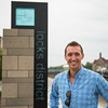 JOED VIERA/STAFF PHOTOGRAPHER-Lockport, NY- Brian Smith stands in front of the Locks District sign.