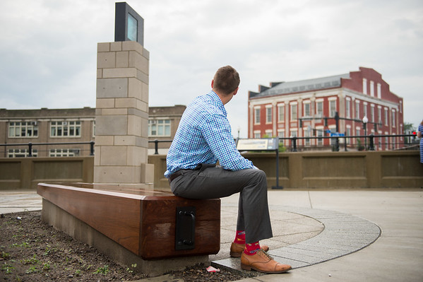 JOED VIERA/STAFF PHOTOGRAPHER-Lockport, NY- Brian Smith sits admiring the Locks District sign.