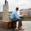 JOED VIERA/STAFF PHOTOGRAPHER-Lockport, NY- Brian Smith sits admiring the Locks District sign.