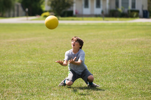 JOED VIERA/STAFF PHOTOGRAPHER-Lockport, NY- Ethan Perkins, 13, dives for a catch during a YWCA Niagara Frontier Summer Day Camp kickball game.
