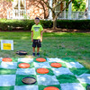 Gavin Fluellen, 7, crushes his grandmother Mary Klapp in a giant game of checkers on the Kenan House's front lawn.