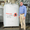 JOED VIERA/STAFF PHOTOGRAPHER-Lockport, NY-  Bill Robbins stands by a bag of recycled rubber at Rubberform.