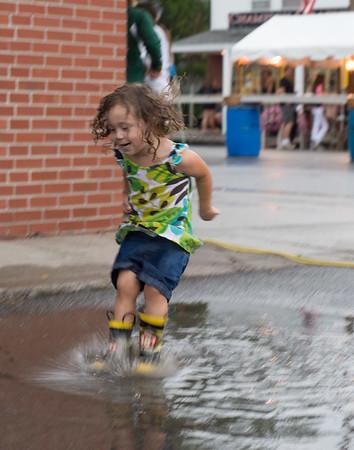 JOED VIERA/STAFF PHOTOGRAPHER-Wilson, NY-Ellie Craig 3 splashes ino a puddle during Wilson's Field Days.
