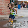 JOED VIERA/STAFF PHOTOGRAPHER-Wilson, NY-Ellie Craig 3 splashes ino a puddle during Wilson's Field Days.