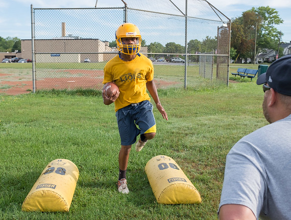 JOED VIERA/STAFF PHOTOGRAPHER-Lockport, NY- Mason Bovain, 18, drills during Lockport High School's first football practice of the season.