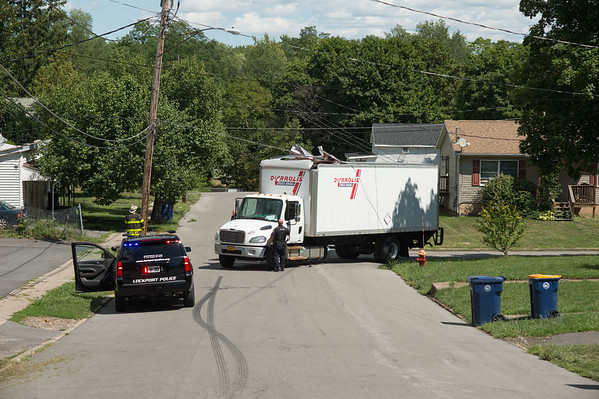 JOED VIERA/STAFF PHOTOGRAPHER-Lockport, NY- Crews responed to a downed utility pole on Williams Street and Scovel Street.