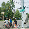JOED VIERA/STAFF PHOTOGRAPHER-Newfane, NY-A group of kids ride their bikes down Main Street.
