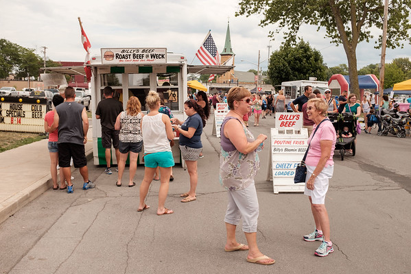 JOED VIERA/STAFF PHOTOGRAPHER-Lockport, NY-Patrons line up for Billy's Beef at Taste of Lockport.