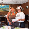 JOED VIERA/STAFF PHOTOGRAPHER-Lockport, NY-Betty Jo Hanna and Jennifer Serano go over the winners of Taste of Lockport.