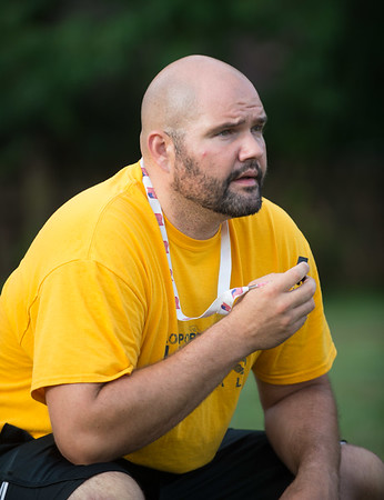 JOED VIERA/STAFF PHOTOGRAPHER-Lockport, NY-Head Coach Matt Vermette talks to players during Lockport High School's first football practice of the season.