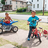 JOED VIERA/STAFF PHOTOGRAPHER-Lockport, NY-Jystice Woods, 4, and Xavier Toledo, 4, play in their front yards.