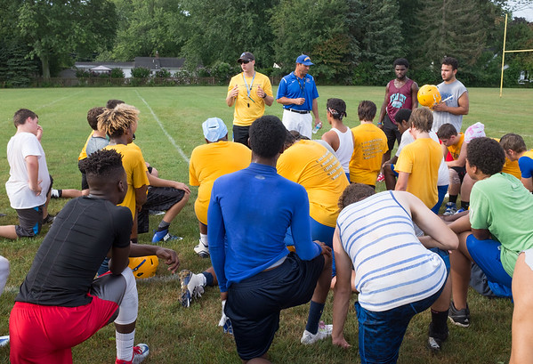 JOED VIERA/STAFF PHOTOGRAPHER-Lockport, NY- Players listen to coaches during a break in Lockport High School's first football practice of the season.