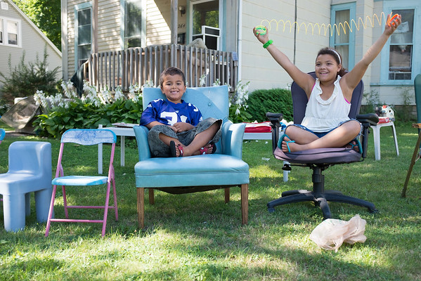 JOED VIERA/STAFF PHOTOGRAPHER-Lockport, NY-Aviyon, 4, and Ashayliana Pritchard, 9, help out their mom at a yard sale on Locust Street.