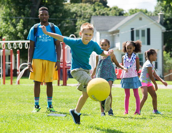JOED VIERA/STAFF PHOTOGRAPHER-Lockport, NY-Cameron Pittler 9 kicks during a game of kickball on the last day of the YMCA Day Camp.