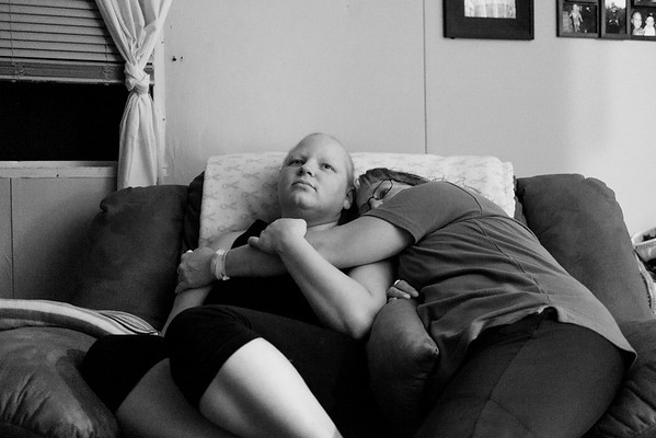 JOED VIERA/STAFF PHOTOGRAPHER-Lockport, NY-   Katie Jo Perry and her mother Tammy Clines embrace the night before her surgery.