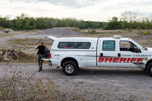 JOED VIERA/STAFF PHOTOGRAPHER-Gasport, NY-  Erie County Sheriff's Bomb Squad's Daniel  covers his ears before a blast.
