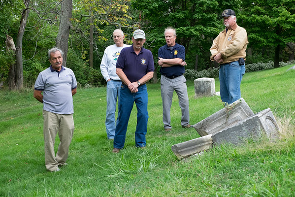 JOED VIERA/STAFF PHOTOGRAPHER-The men stand by the destroyed memorial.