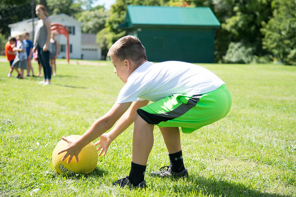 JOED VIERA/STAFF PHOTOGRAPHER-Lockport, NY- Conner Baehr 9 catches during a game of kickball on the last day of the YMCA Day Camp.