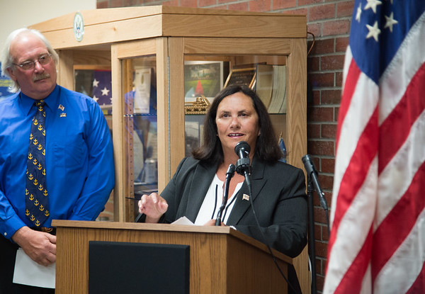 JOED VIERA/STAFF PHOTOGRAPHER- Lockport, NY- Pat Seijak watches as Pat Pat Dufour speaks during the Veterans Display Case Dedication Ceremony.
