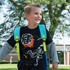 JOED VIERA/STAFF PHOTOGRAPHER-Lockport, NY- Ronald Beauman-Kureczka, 7, walks back home after his first day at Charles Upson.