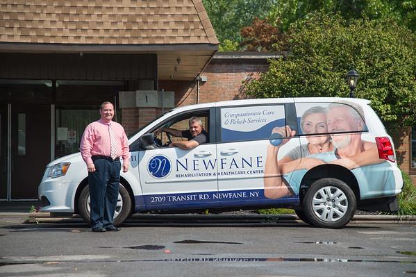 JOED VIERA/STAFF PHOTOGRAPHER- Lockport, NY-Matt McDougall and Jim Haas show off the facility's new van.