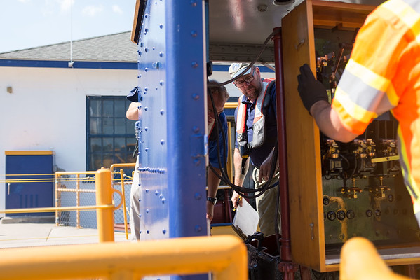JOED VIERA/STAFF PHOTOGRAPHER-Lockport, NY-John McKee watches as Darren Mcguirk inspects a switchbox at the Locks.