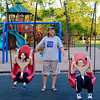 JOED VIERA/STAFF PHOTOGRAPHER-Lockport, NY-  Eric Bluff pushes his twins Brooke and Hunter Bluff, both 7 on a swing set at Day Road Park.